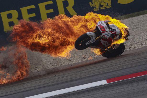 https://i2-prod.mirror.co.uk/incoming/article6695173.ece/ALTERNATES/s615/Jack-Millers-Honda-bike-bursts-into-flames-at-the-Sepang-Circuit.jpg