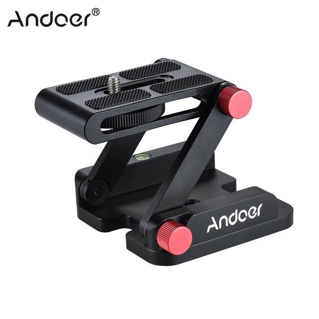 https://ae01.alicdn.com/kf/HTB1Bd.1PFXXXXakXFXXq6xXFXXXB/Andoer-Nieuwe-Z-vormige-Quick-Release-Plaat-Opvouwbare-Camera-Desktop-Houder-Tilt-Hoofd-voor-Canon-Nikon.jpg_640x640.jpg