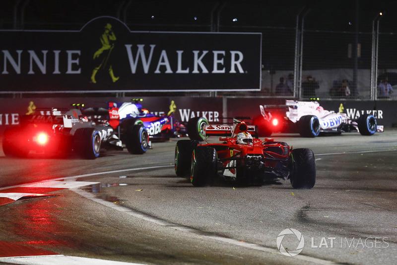 https://cdn-8.motorsport.com/images/mgl/25kWe3x6/s8/f1-singapore-gp-2017-sebastian-vettel-ferrari-sf70h-loses-the-nose-of-his-car-after-a-coll.jpg