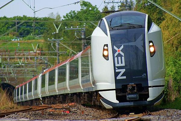 https://upload.wikimedia.org/wikipedia/commons/thumb/2/29/The_Narita_Express_train_running_a_natural_woodland.JPG/600px-The_Narita_Express_train_running_a_natural_woodland.JPG
