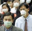 Mensen met mondkapjes ivm SARS