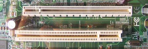 CeBIT 2004: detailshot PCI Express- + PCI-slot