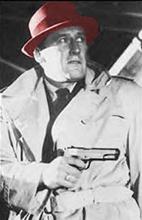 Mickey Spillane met rode hoed