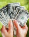 Hand met dollars