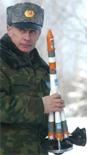 Vladimir Poetin met draagraketje