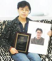 Moeder Shi Tao met foto