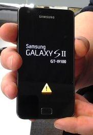 Galaxy S2 met gele driehoek