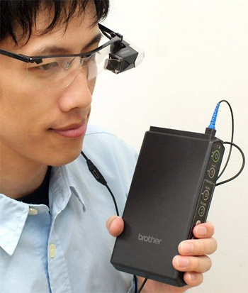 Brother retinal scanning display