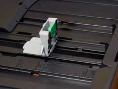 Geleiding papierlengte onderste lade