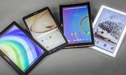 Vier tablets uit de middenklasse
