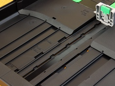 Geleiding papierlengte bovenste lade
