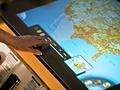 Microsoft Surface in telecomwinkel - bediening van overzichtsmap