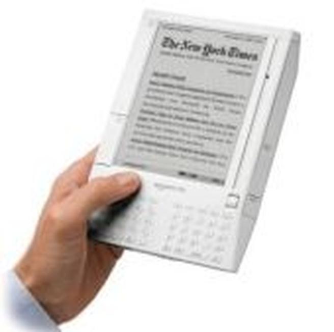 Amazon Kindle in hand