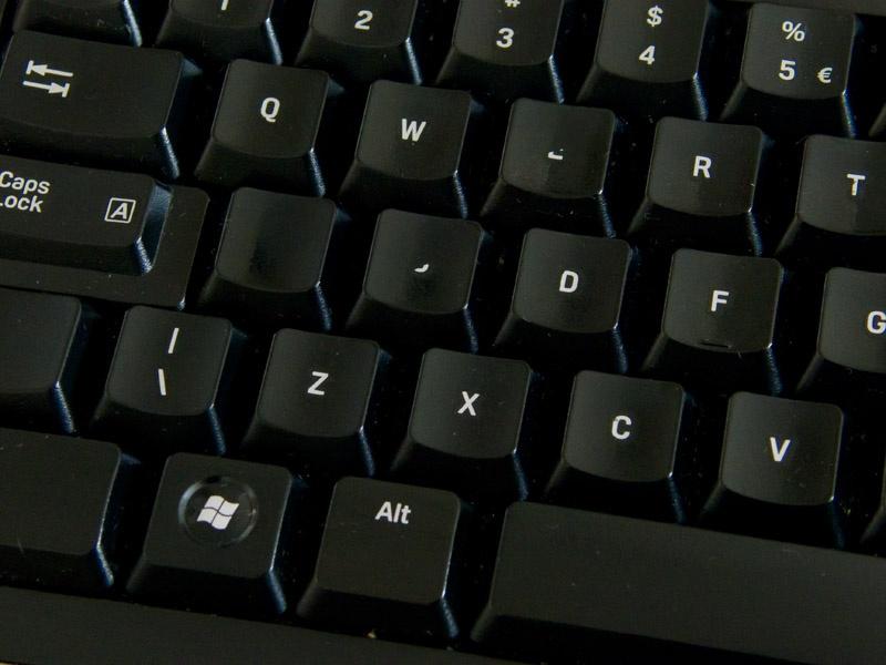 Closeup van toetsen slijtage op een Logitech S510 desktop set